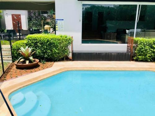 Travertine pavers surrounding pool