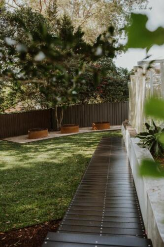 SPRINGWOOD garden makeover corten rings, treated pine edging and turf