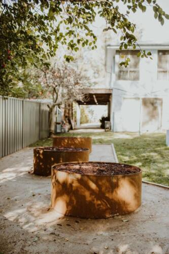 SPRINGWOOD garden makeover  driveway makeover, corten rings for orchard area