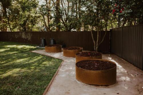 SPRINGWOOD garden makeover  corten rings for orchard area, treated pine edging and turf.