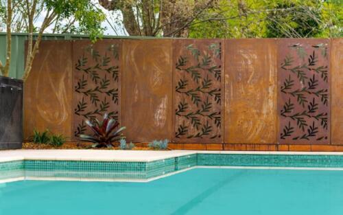 Corten steel screens for pool fence