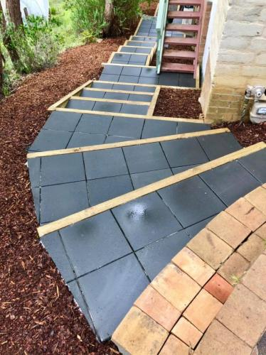 Curved paved garden stairs