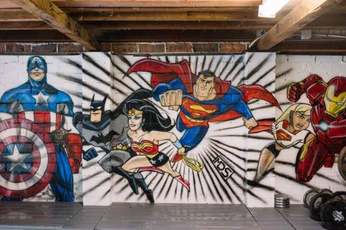 super hero mural on garage wall