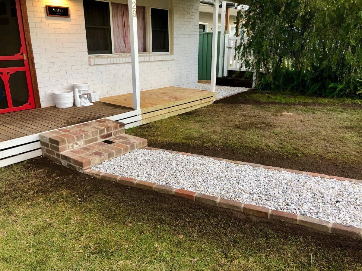 Gravel pathway to brick steps