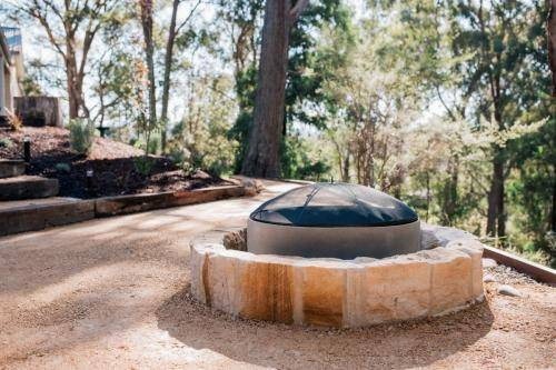 Sandstone Fire Pit Surrounded by Gravel