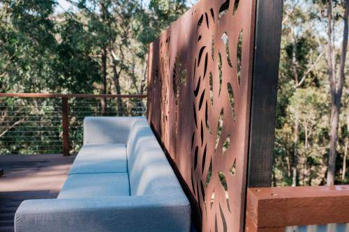 Corten privacy screen behind Outdoor Sofa