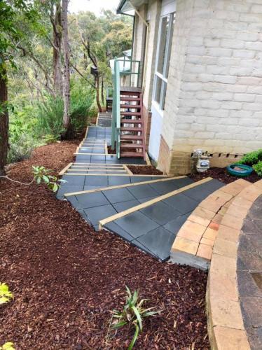 Mulched sloped garden beds