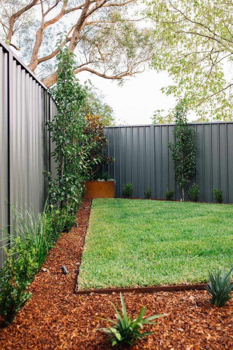 backyard lawn and mulched garden beds