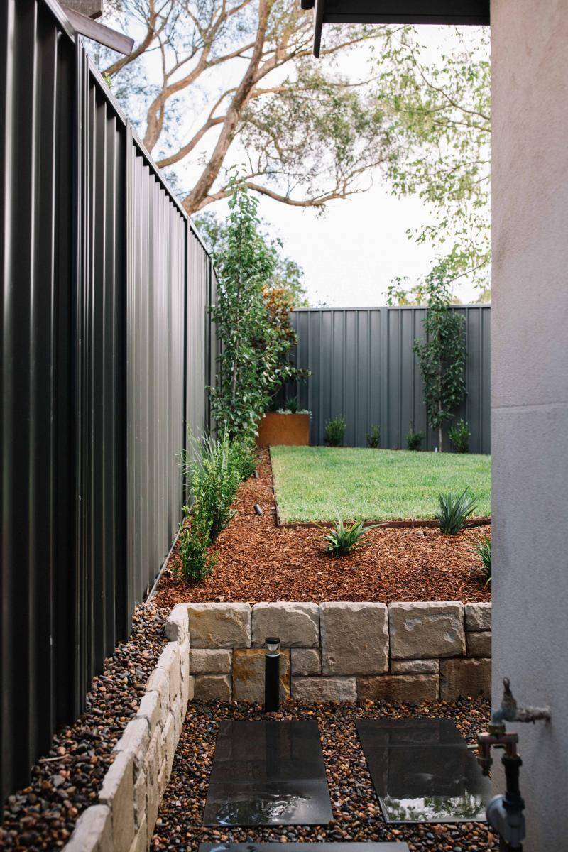 Lawn edged with mulched garden beds